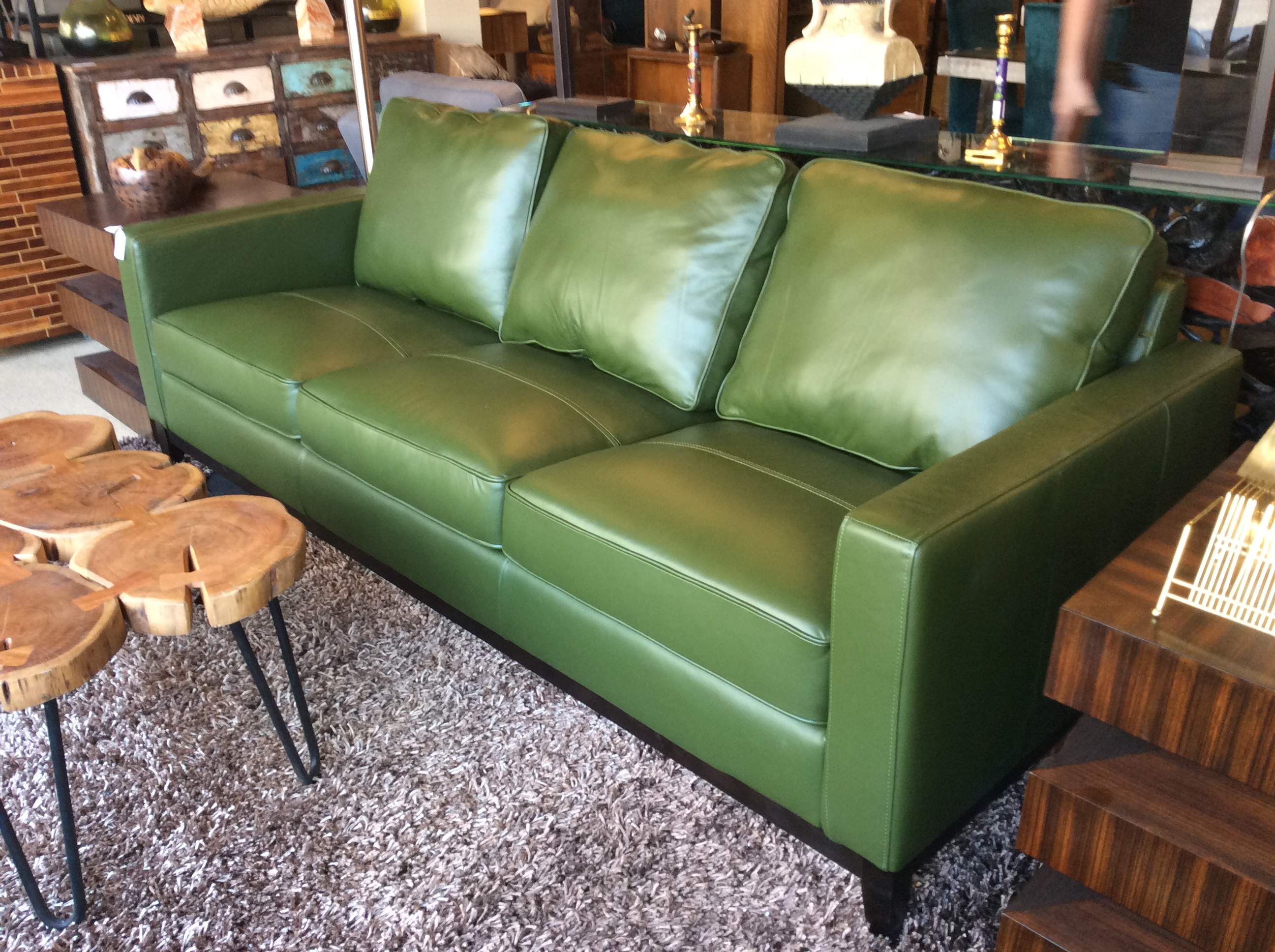 Green leather sofa sold